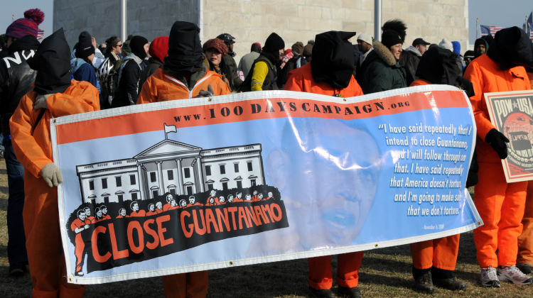 WASHINGTON - JAN 20: Hooded demonstrators hold a sign as they demand the closing of Guantanamo at the inauguration of U.S. President Barack Obama on January 20, 2009 in Washington.