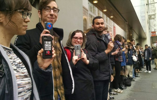 young people protest the FBI outside an Apple store in San Francisco