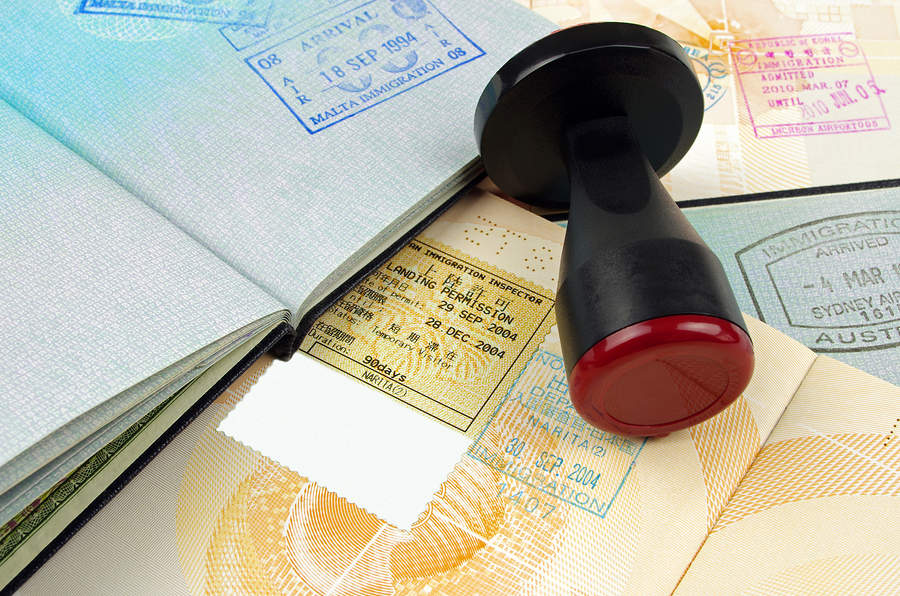 various passport pages with a customs stamping tool