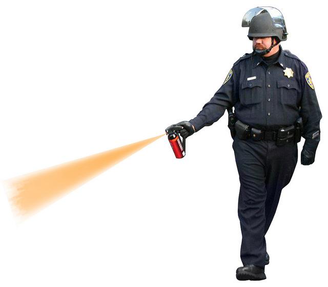 stylized photo of UC Davis cop pepper spraying