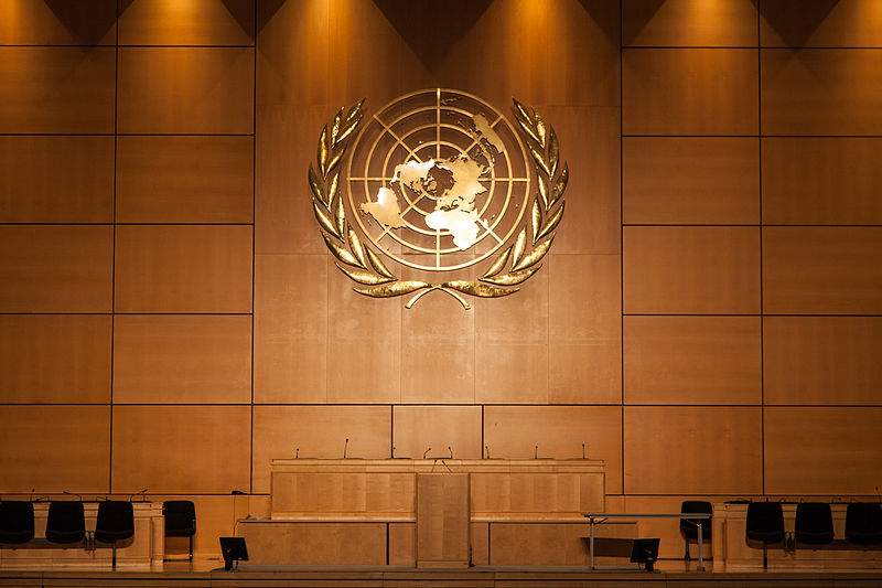 photo of UN Assembly Hall with UN Logo in gold