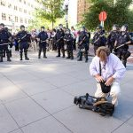 Riot cops surround news photographer in St. Paul at RNC