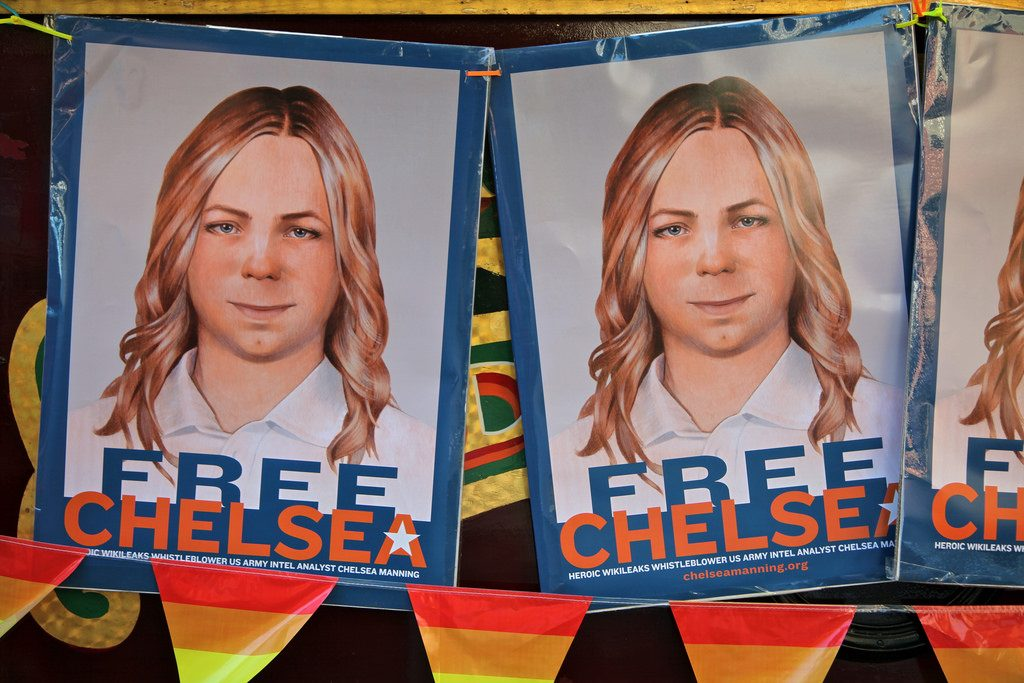 banners with Chelsea Manning picture at SF gay pride parade