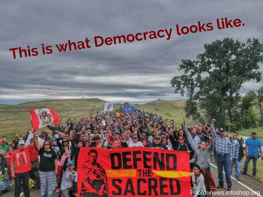 protesters march down north dakota highway against DAPL