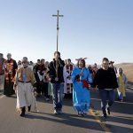 religious leaders march on highway at standing rock