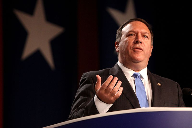 Mike Pompeo against background of stars from US flag
