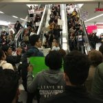 protesters against the Muslim ban at San Francisco airport jam the escalators