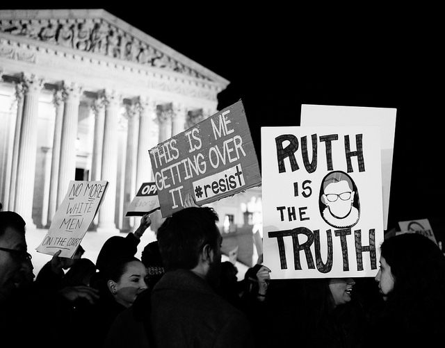 "nightime protest signs say ""Ruth is the truth"" and ""resist"""