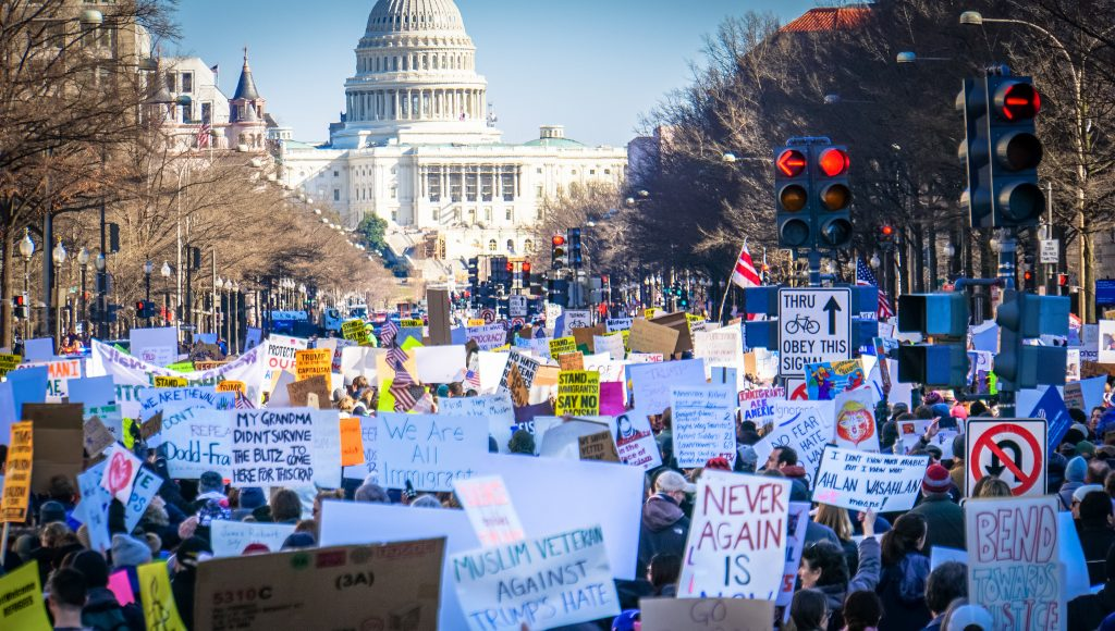 protesters at US Capitol with signs opposing Trump and Muslim ban