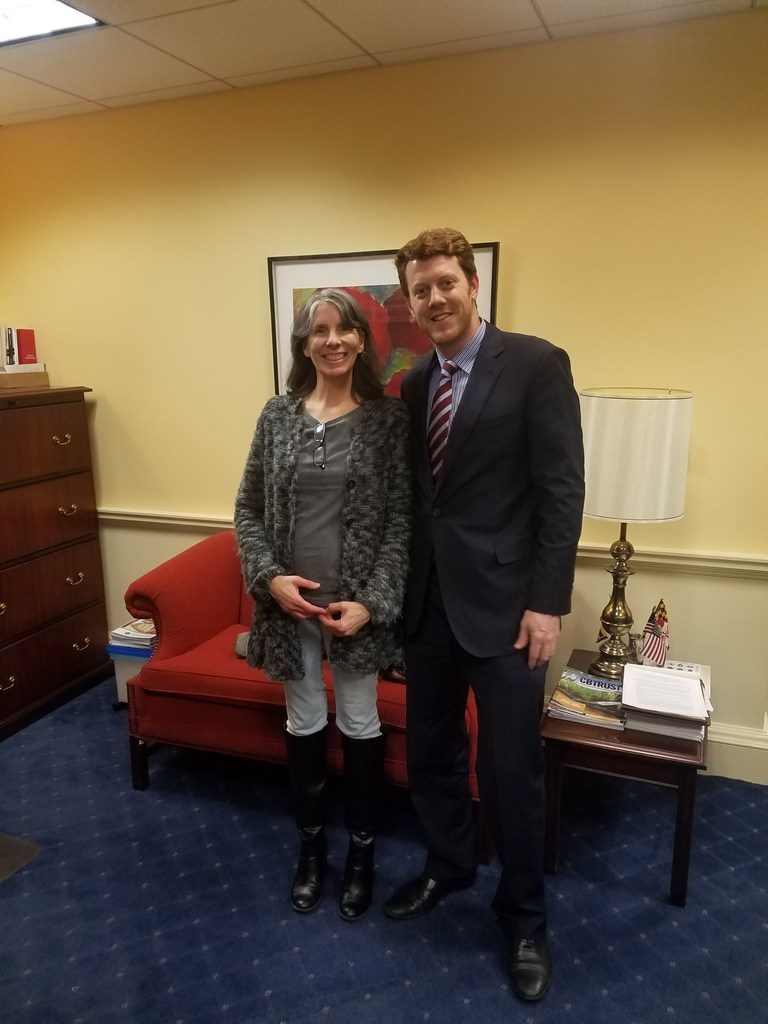beautiful sue udry poses with Michael Lore in delegate lee's office