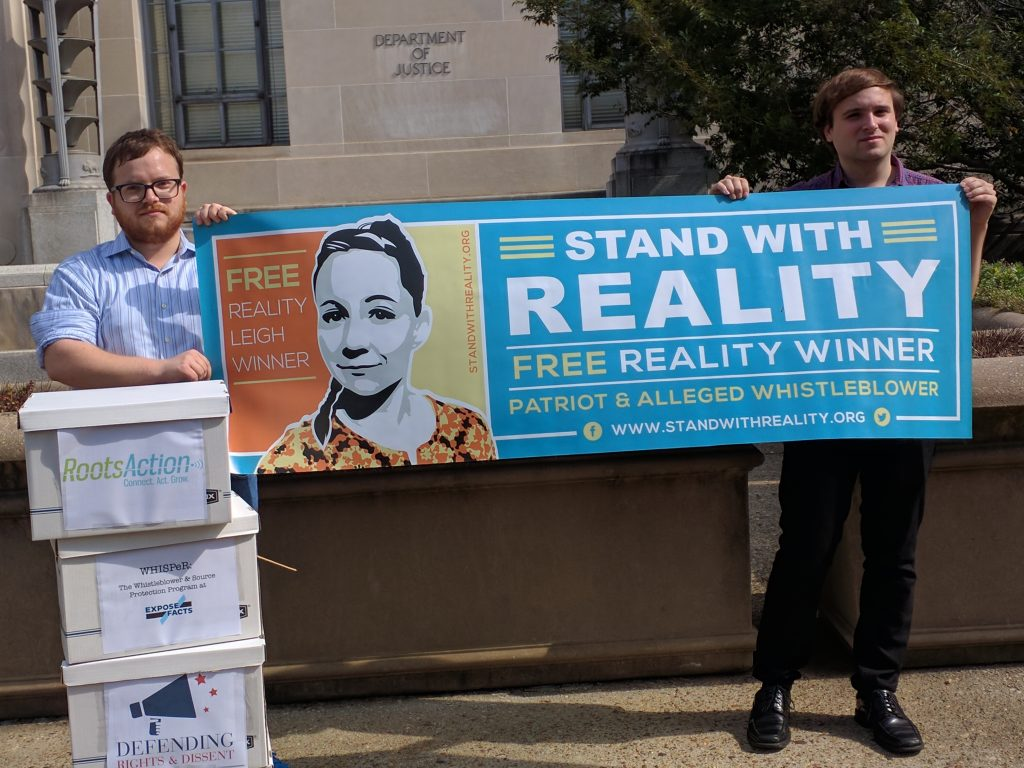 """Stand with Reality"" banner in front of dept.l of justice"