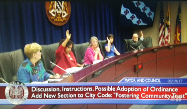 3 members of city council raise their hands to vote for FCT ordinance