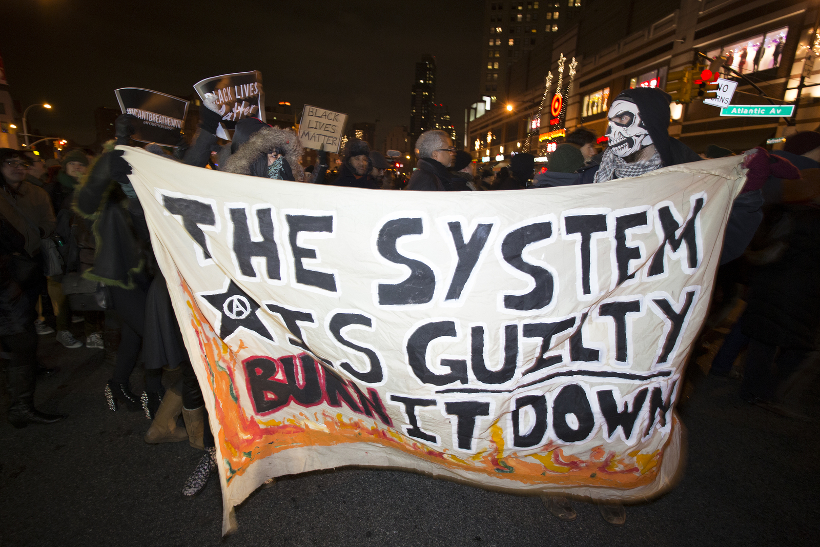 """NEW YORK CITY - DECEMBER 8 2014: several hundred demonstrators filled Barclay's Center during a visit by the Duke & Duchess of Cambridge in a """"Shut it down!"""" protest against alleged police brutality."""